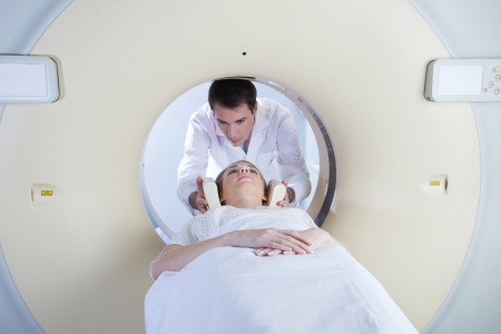 radiotherapy: woman in a ct scan with medical professional