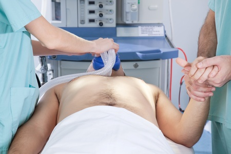 An anesthetist preparing a patient for surgery Stock Photo - 10033239