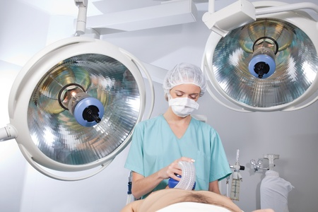 ventilator: Anesthetist watching over patient before surgery