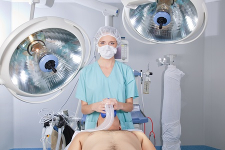 An anesthetist with patient in an operating room photo
