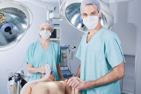 Doctor nursing the patient before operation in hospital Stock Photo - 10033221