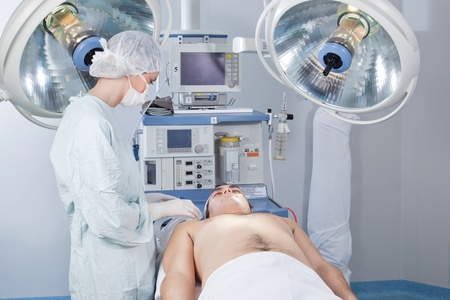 Surgeon checking the patient before operation in operating room photo