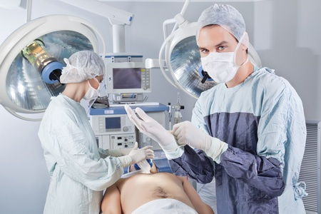 Doctor getting ready before the operation in operating room photo