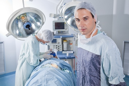 ventilator: Confident male doctor in operating room Stock Photo