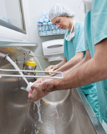 Surgeons washing hands before operation photo
