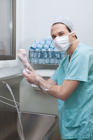 hand washing: Young male doctor wearing mask and washing hands