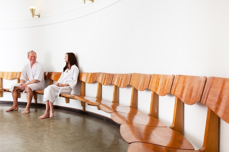 A man and woman in a retro style spa reception photo