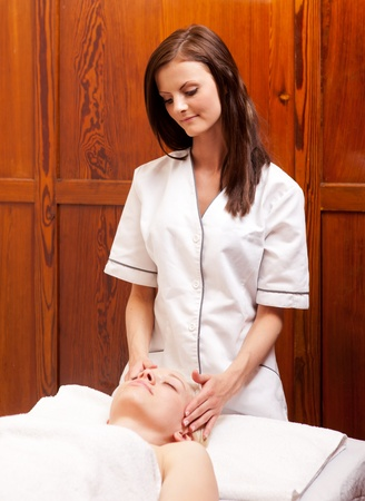 A massage therapist in an old style spa photo