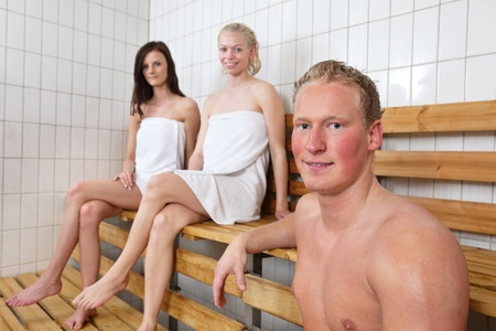 bathhouse: Group of people in a warm room at a sauna spa Stock Photo