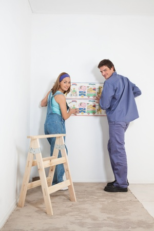 Portrait of smiling couple hanging baby wallpaper photo