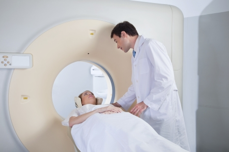 Doctor examining patient before CT scan photo