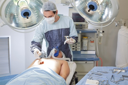 medical ventilator: Doctor with masks performing surgery in operating theater