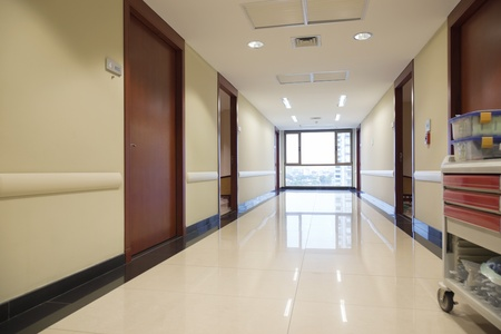 emergency cart: Clean reflective passageway of hospital with window Stock Photo