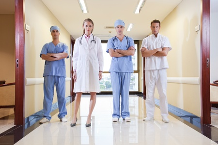 practitioner: Team of doctor and nurse standing in hallway of hospital