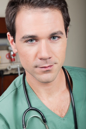 Close-up portrait of young male surgeon photo