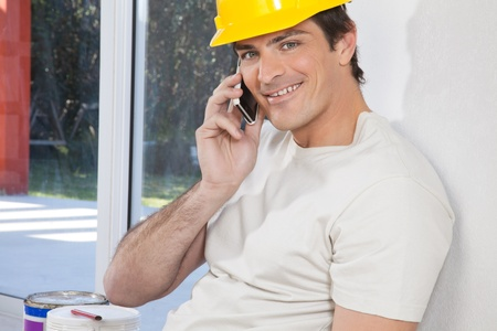Portrait of construction worker talking on phone Stock Photo - 10127198