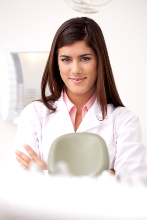 dental hygienist: A young woman dentist smiling looking at the camera