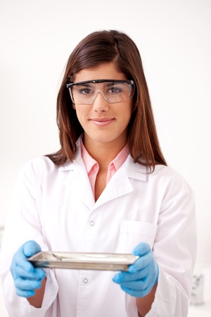 dental hygienist: Dentist holding stainless steel tray of sterile tools Stock Photo