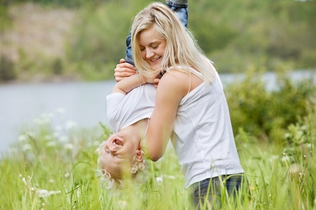 Playful woman in park playing with her laughing son Stock Photo - 10336931