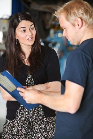 angry blonde: An upset female customer at a mechanic shop