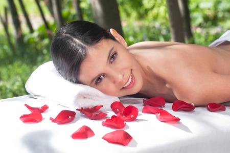 Portrait of a charming woman lying on a massage table in a health spa Stock Photo - 10451777