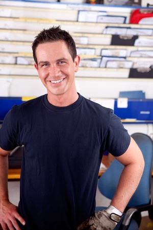 Portrait of a young man mechanic smiling, looking at the camera photo