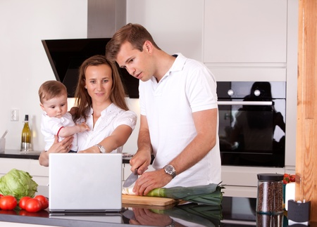 Happy Family in Kitchen Preparing Meal photo