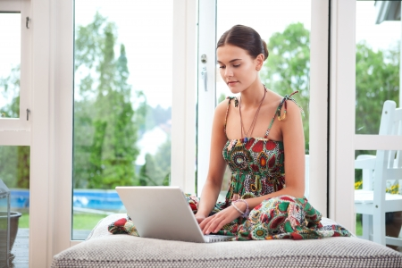 chat room: Young woman working on her laptop