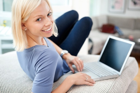 chat room: Portrait of happy blond woman using laptop