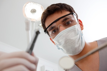protective goggles: Dental technician with cleaning tools
