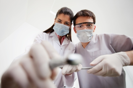 doctor mask: Female dentist and technician with cleaning tools Stock Photo
