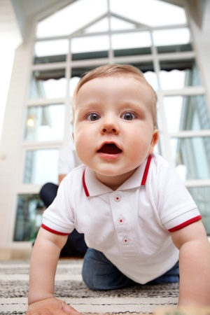 Portrait of cute adorable child at home photo