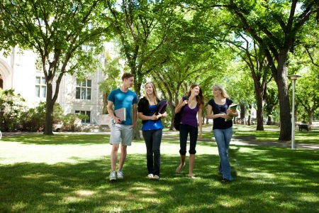 Students walking through campus visiting photo