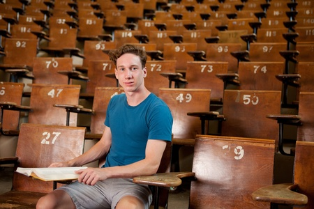 Portrait of a young university student sitting in a lecture hall photo