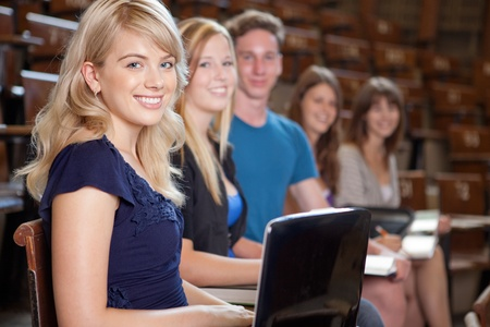 Group of students looking at camera in a university lecture hall Stock Photo - 10559804