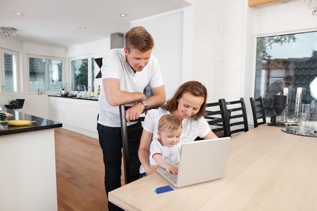 Family working on laptop together at home photo