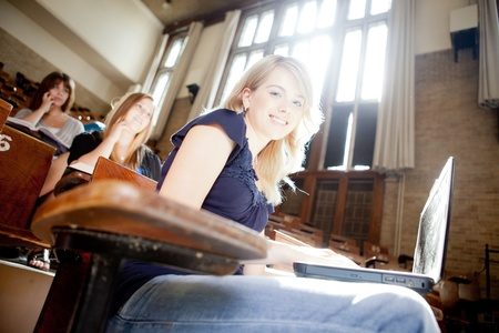 college classroom: Students in a lecture hall with strong backlighting Stock Photo