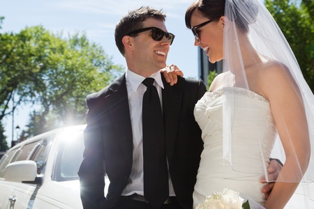 limo: Happy married couple wearing sunglasses Stock Photo