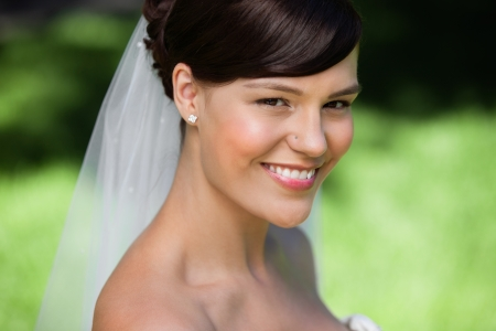 Portrait of a beautiful young bride smiling Stock Photo - 10723081
