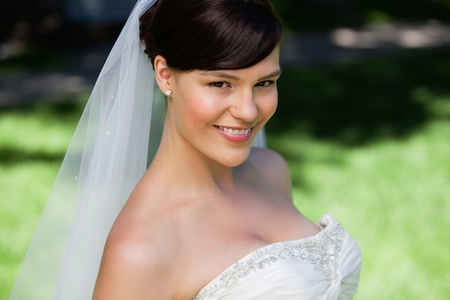 Close-up portrait of a pretty young bride smiling photo