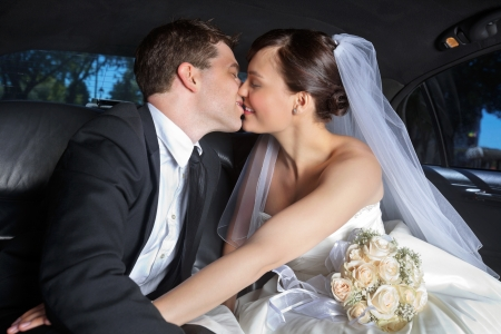 Newlywed couple kissing each other Stock Photo