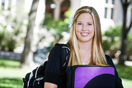Portrait of sweet looking college girl with backpack Stock Photo - 10723342