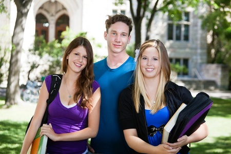 college building: Group portrait of three college students Stock Photo