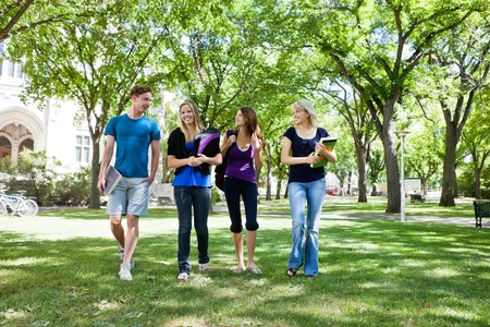 school campus: Group of college students walking in campus ground
