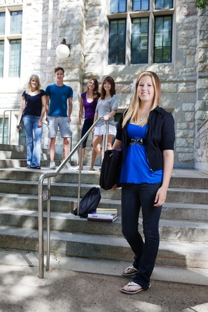 freshmen: College students on the stairs of college building