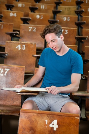 studious: Young studious boy studying at university hall