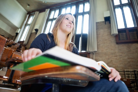 Low angle view of young college girl paying attention in lecture Stock Photo - 10762524