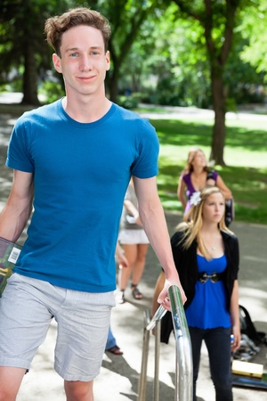 freshmen: College student outdoors on way to class