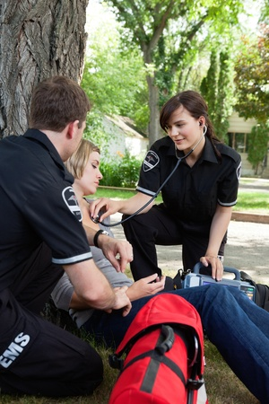 medical emergency service: Emergency medical service attending to a injured patient
