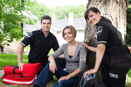 first responder: Portrait of emergency team with healthy recovering patient